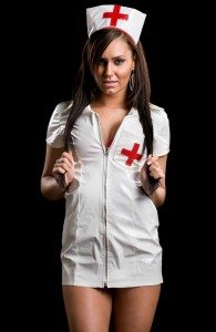 Very sexy woman in kinky nurse outift isolated on black background
